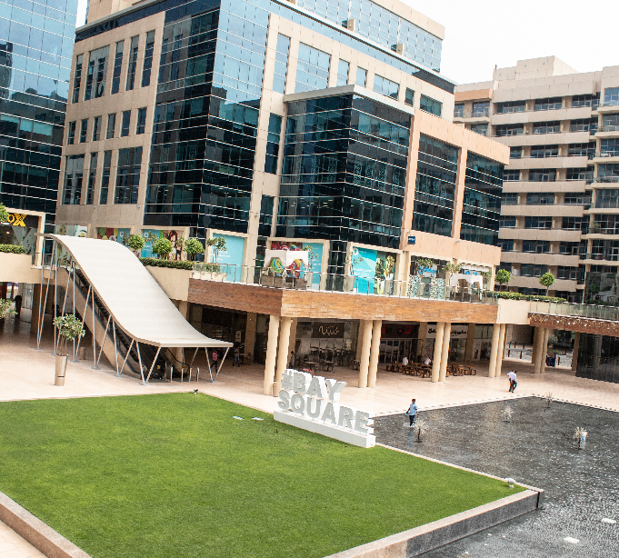 External view of Bay Square buildings, grass and fountains
